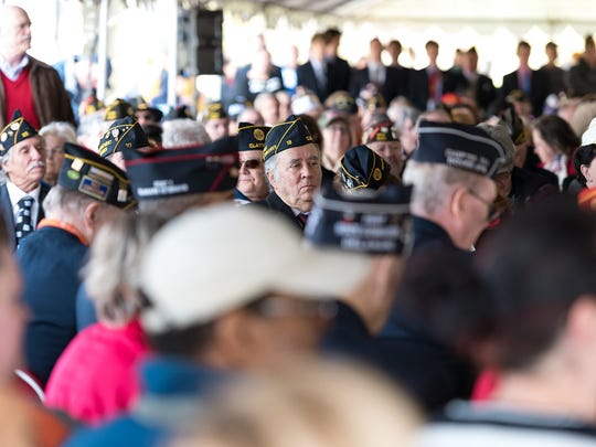 Large numbers of veterans attend a Veterans Day celebration at Veterans Memorial Park in New Castle.