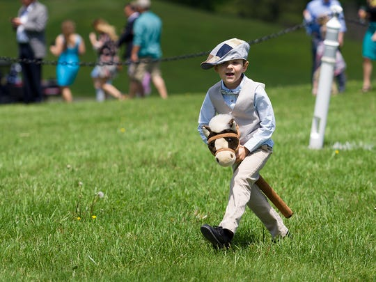 New Jersey's Cameron Quinn, 6, has fun on a stick horse at Winterthur's Point to Point last May.