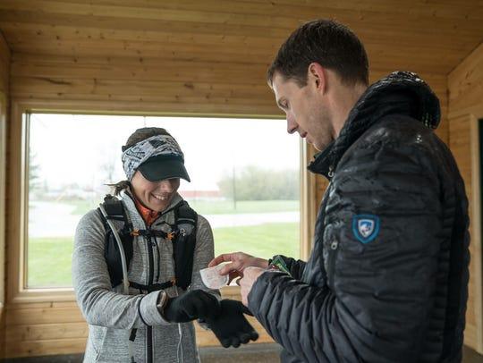 Annie Weiss gets some handwarmers from her boyfriend,