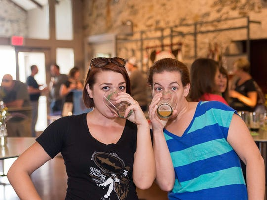 """Alli Schell (left) and Allison Haug at """"Delaware: A Brew Story"""" in 2015 at Blue Ball Barn in Rockland."""