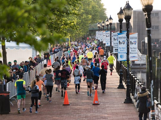Runners at the 14th annual Discover Bank Delaware Marathon at Tubman-Garrett Riverfront Park in Wilmington.