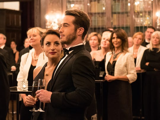 """Ryan Carnes (center) finds himself competing with his fiancee's (Marimar Vega) past and family in """"La Boda de Valentina."""""""