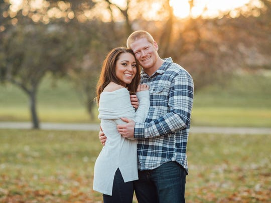 Simmone Doswell and Spencer Clock, 23, of Johnston, are getting comparisons to Prince Harry and Meghan Markle.