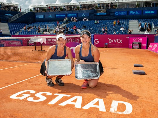 Desirae Krawczyk (left) celebrates her first WTA title