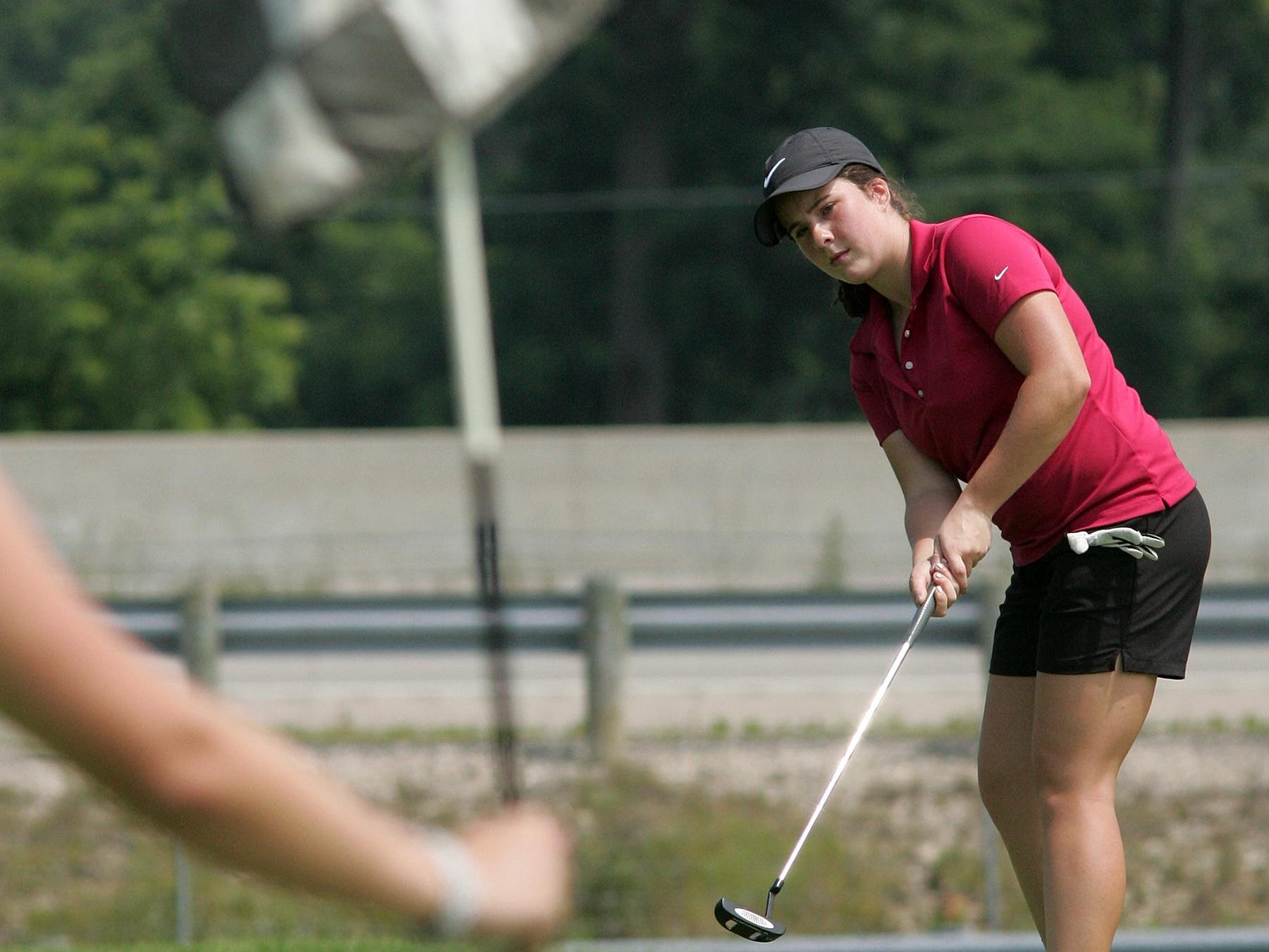 Heath senior Annie Newhouse putts on the 17th green during Monday's Licking County Junior Golf Association match at Raccoon International. Newhouse shot 82 to win the girls match.
