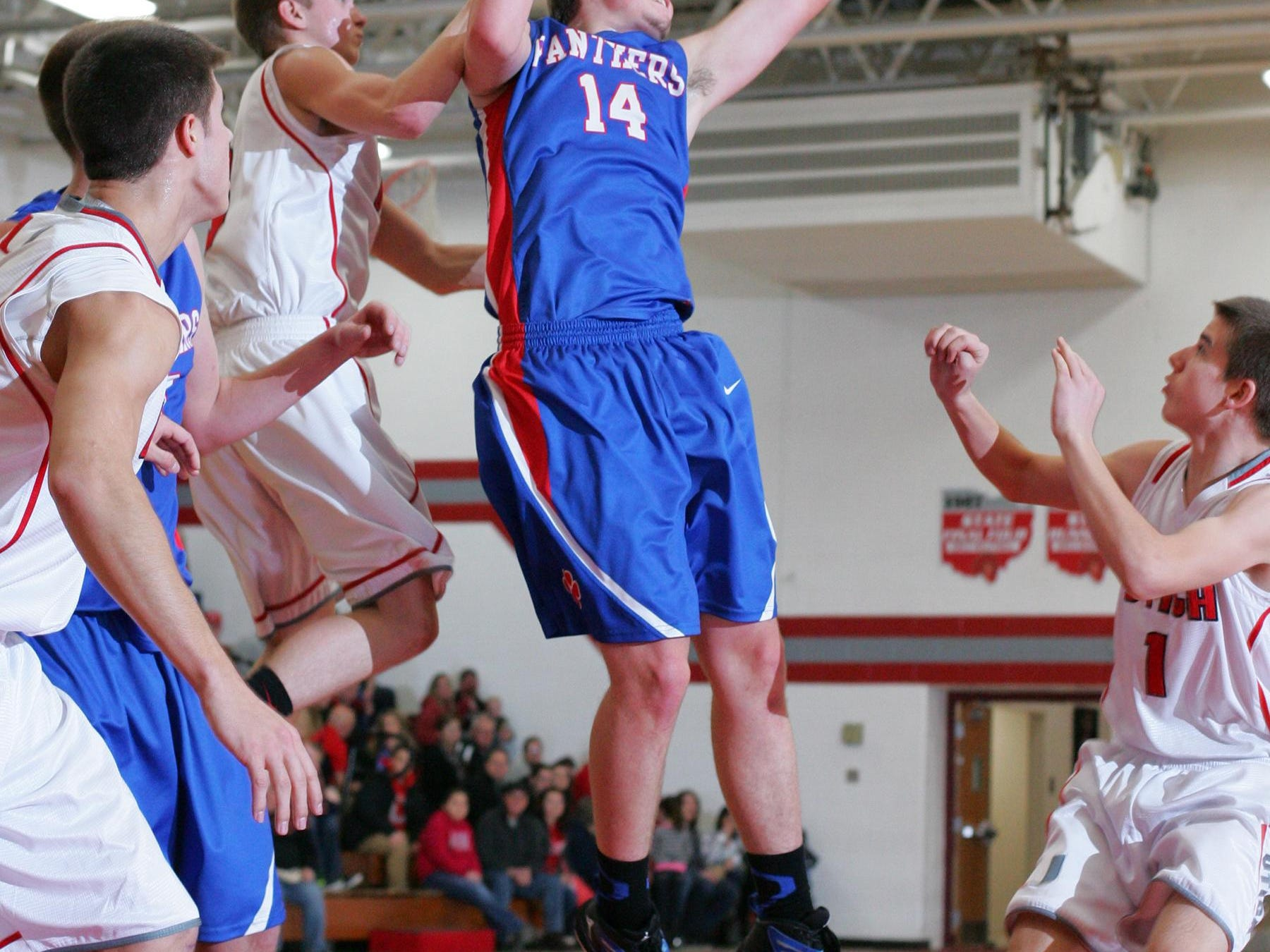Licking Valley's Cole Nethers grabs a rebound during a 2014-15 game against Utica.