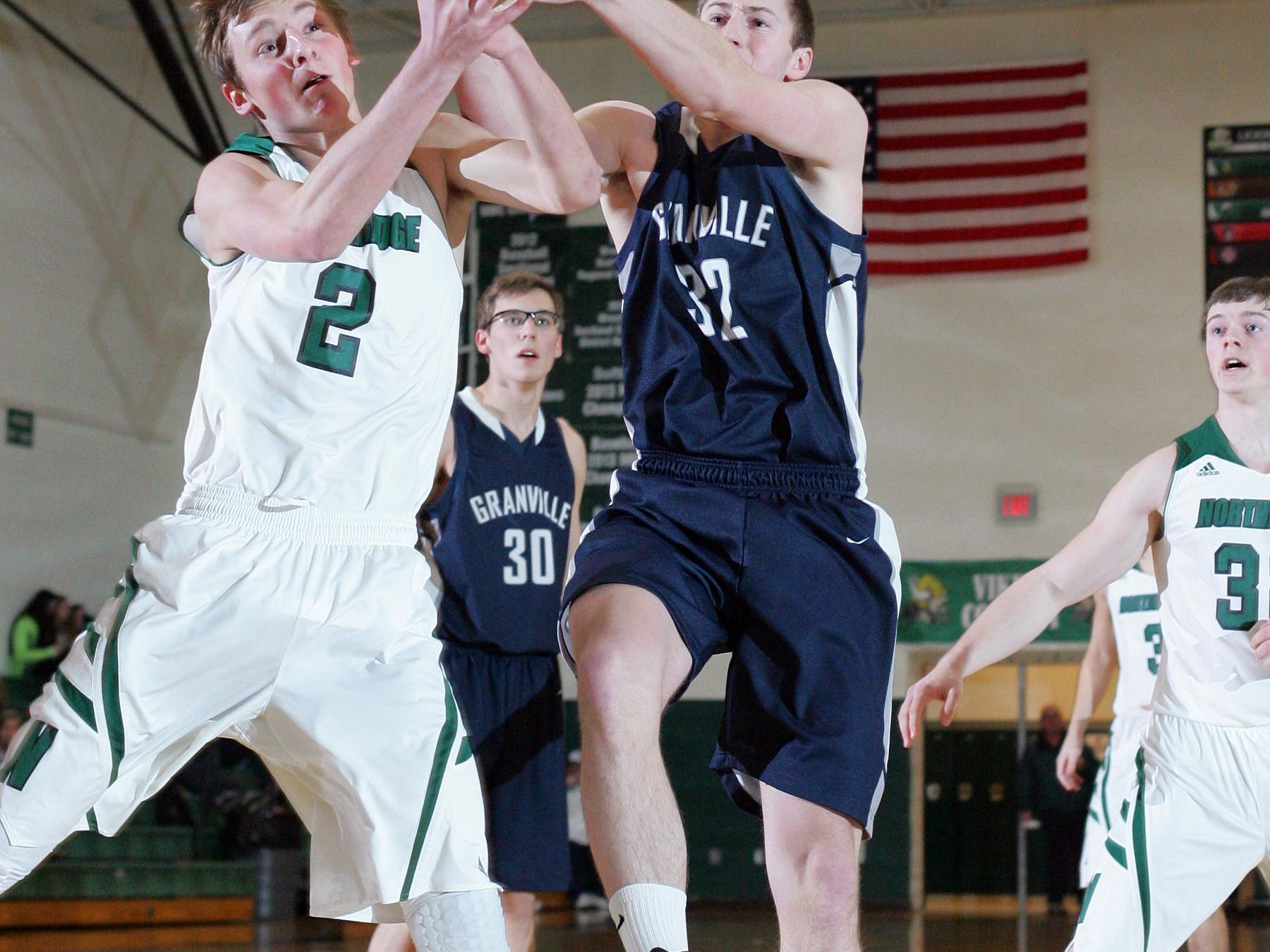 Northridge's Daniel Hatfield battles a Granville player for a loose ball during a 2014-15 game.