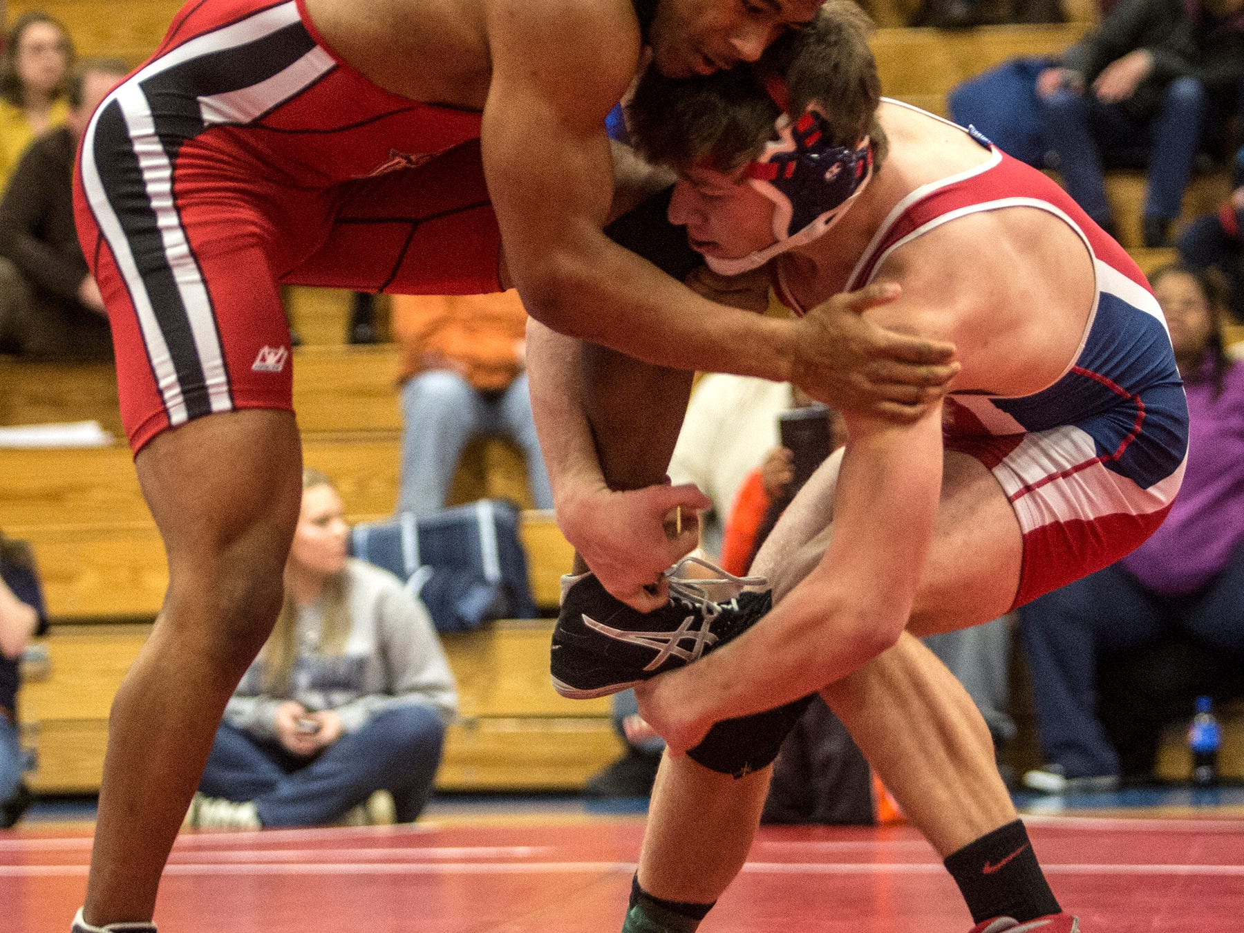 Ethan Fout of Licking Valley won a 3-2 decision against Marion-Franklin's Brandon Fort to win the 160-pound Division II sectional title Saturday on his home mats.