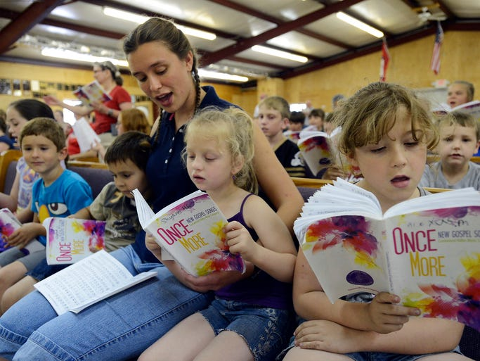 Elizabeth Anderson sings with her beginner students Tuesday at the Brockwell Gospel Music School. The school, which teaches traditional shape note music, is in its 67th year.