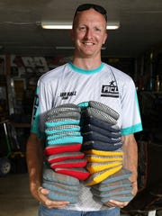 Brian Hall with a small selection his bean bags. Hall has bags for all conditions and strategies.