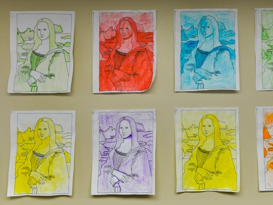 Sixth-graders used watercolor crayons to create monochromatic versions of the Mona Lisa while creating pop culture art from masterpieces of the past.