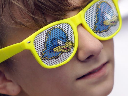 """Ainsley LiCata, 12, of Basking Ridge, NJ, watches a wing-eating contest during the """"Fandemonium"""" preceding the Blue-White Football Spring Game at Delaware Stadium, Saturday May 3, 2014."""