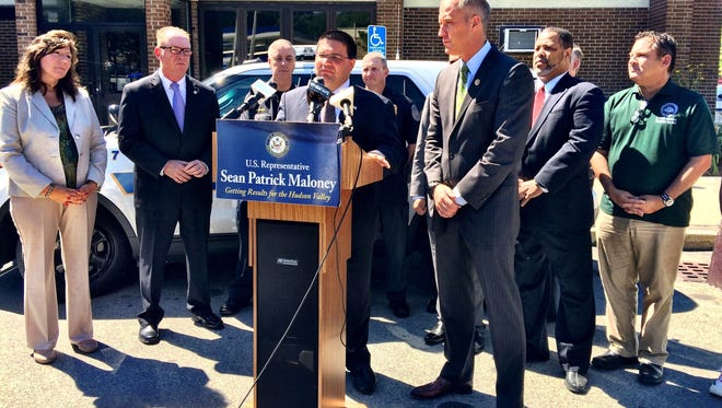 Local, state and federal officials, on Aug. 13, 2015, gather to call for more police protection in the City of Poughkeepsie after several shootings in the city