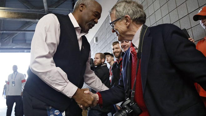 Ohio State athletic director Gene Smith greets Ohio Gov. Mike DeWine as the team enters the stadium before the College Football Playoff semifinal in Glendale, Ariz., on   Dec. 28, 2019.