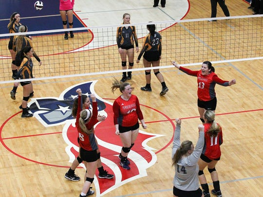 Powdersville High School celebrates match point against Crescent at the end of the third set Class AAA third round action at Powdersville High School in Powdersville. Powdersville won 3-0.