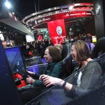 From left, FCA engineers Linda Hess laughs as Kathy Wehbe drives the 2017 Ford F-250 Super Duty simulator during Industry Days at the North American International Auto Show at Cobo Center in Detroit on Wednesday, Jan 13, 2016.