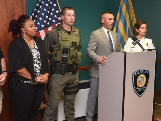 """Salisbury Mayor Jake Day, center, talks about the restraint that Sgt. Richard Engle, left of Day, used as fellow officers, Corp. Jason Harrington, left, and Pfc. Lisa Perdue listen at a press conference about Engle discharging his weapon during a """"man with a gun call"""" at Woodcock Park at Pennsylvania Avenue and Riverside Road Tuesday night. At right, Police Chief Barbara Duncan looks on."""