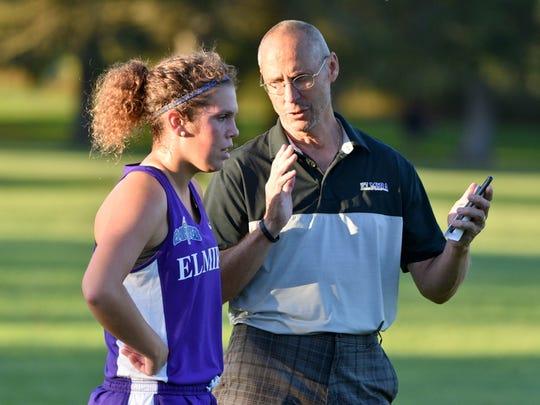 Lou Fiorillo talks with Claire Preisch of the Elmira women's team this season.