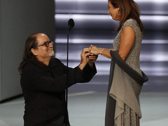 Producer Glenn Weiss proposes to his girlfriend Jan Svendsen onstage during the 70th Primetime Emmy Awards at the Microsoft Theater in Los Angeles on Monday, Sept. 17, 2018. (Brian van der Brug/Los Angeles Times/TNS)
