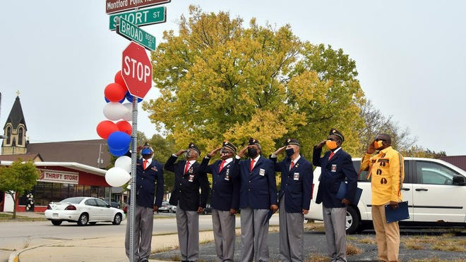Members of the Beloit-Rockford Montford Point Marines Association stand together Saturday to recognize the honorary street renaming of Short Street to Montford Point Marine Street.