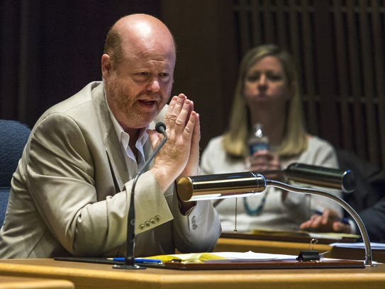 New Castle County Councilman David Tackett speaks during