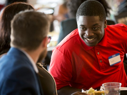 Dwight Bunton, 19, sits with loved ones at an awards dinner for Bunton and other graduating high school seniors who've participated in Dream Alive, a mentorship program founded by former Colts player Tarik Glenn, Indianapolis, Wednesday, May 31, 2017.