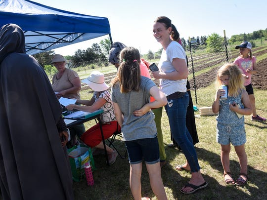 Kendra Roehl helps to organize efforts at a community garden for area refugees Saturday, May 26, at Jubilee Church in St. Cloud.