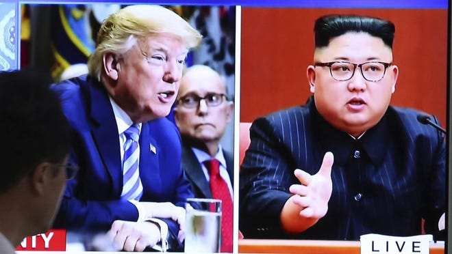 A man watches a TV screen showing file footage of U.S. President Donald Trump, left, and North Korean leader Kim Jong Un during a news program at the Seoul Railway Station in Seoul, South Korea, Thursday, May 24, 2018. North Korea carried out what it said is the demolition of its nuclear test site Thursday, setting off a series of explosions over several hours in the presence of foreign journalists. (AP Photo/Ahn Young-joon)