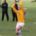 Throwing the ball in for Schoolcraft during a recent game is Canton alum Kelly Schmidt.