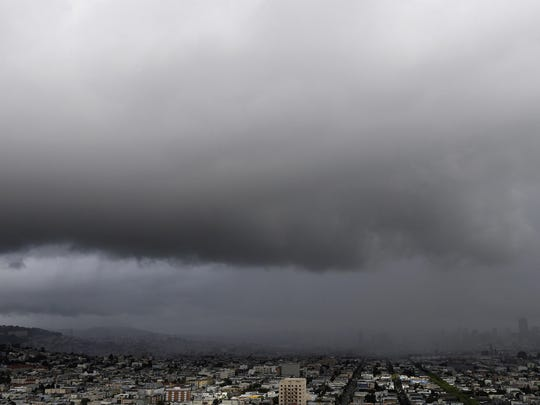 Rain clouds and hail approach from the north as seen from Bernal Heights Hill in San Francisco, Monday, March 7, 2016. Thunder crashed and lightning struck as powerful thunderstorms moved swiftly through California Monday, briefly knocking out power to Los Angeles' airport and walloping the Sierra Nevada with blizzard conditions. A seven-day total could approach 20 inches of rain in Northern California and up to 3 inches in the southern end of the state. (AP Photo/Jeff Chiu)