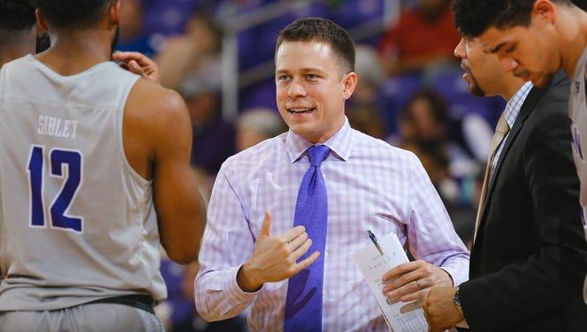 Bob Richey, center, has been named Furman's new men's basketball coach.