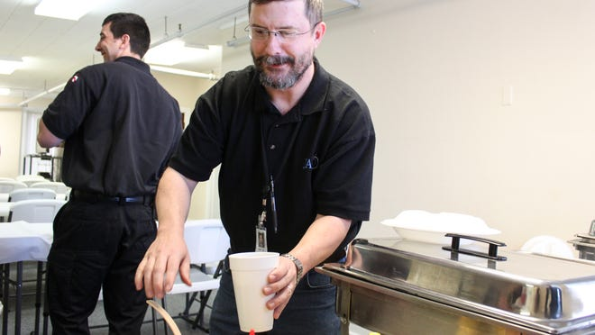 Andy Matthews packs relish for local firefighters to take back to the station Friday afternoon at the Jackson Area Council on Alcoholism and Drug Dependency building Friday afternoon. JACOA hosted a hot dog lunch to thank local firemen and women, police officers and first responders for their service.