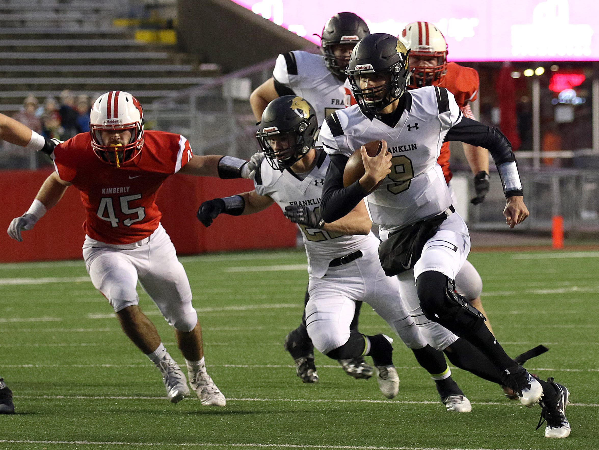 Franklin QB Max Alba rushes the ball during the state
