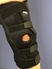 After a viscosupplementation procedure, the patient wears a hinged brace to support the knee and follows a physical therapy regimen.