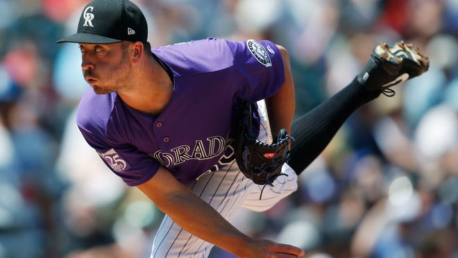 Colorado Rockies starting pitcher Chad Bettis works against the Los Angeles Dodgers in the first inning of a baseball game Sunday, Aug. 12, 2018, in Denver. (AP Photo/David Zalubowski)