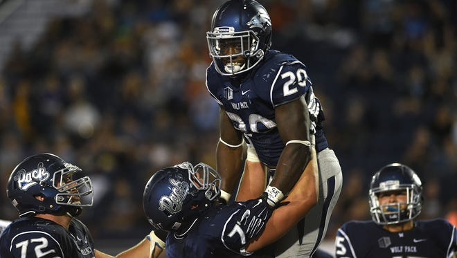 Nevada's James Butler (No. 20) celebrates a touchdown with his Austin Corbett last season. Both have said they will help the youngsters on the team buy into the system implemented by new coach Jay Norvell.