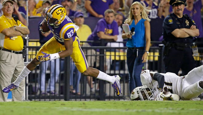 LSU wide receiver Travin Dural (83) pulls in a pass in front of Louisiana-Monroe cornerback Lenzy Pipkins in the Tigers' 31-0 win Saturday. Through three games, Dural has caught 12 passes for 370 yards and four touchdowns.
