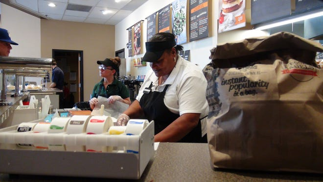 Jackie King, right, prepares breakfast orders at the Bruegger's Bagels in Perinton.