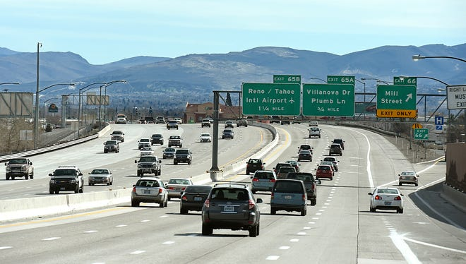 Traffic movies along I-580 next to the Mill Street exit in Reno. Construction starts on Friday night May 15, 2015.