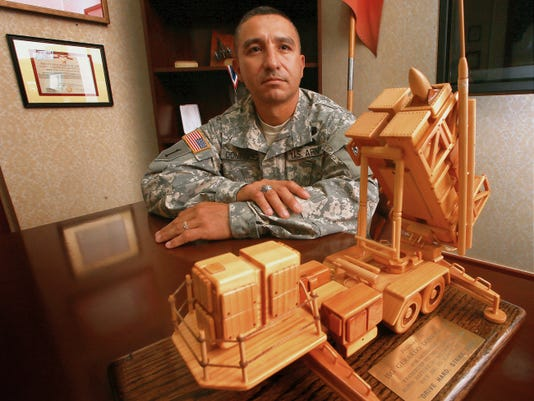 VICTOR CALZADA-EL PASO TIMES Command Sgt. Maj. Gerardo Dominguez is the new top-enlisted soldier for the 32nd Army Air and Missile Defense Command at Fort Bliss. He is an El Pasoan who has come home to fill an important leadership position on post. Dominguez was presented with a wooden Patriot missile launcher for outstanding leadership on a previous assignment.