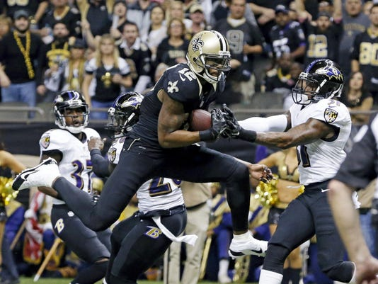 In this file photo, New Orleans Saints wide receiver Marques Colston (12) pulls in a touchdown reception in front of Baltimore Ravens strong safety Matt Elam, middle rear, and free safety Terrence Brooks, right. Elam will miss the entire 2015 season with a biceps injury.