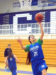 Cavegirls sophomore point guard Mariel Gomez makes a layup during Monday's practice. Carlsbad hosts Hobbs on Thursday.