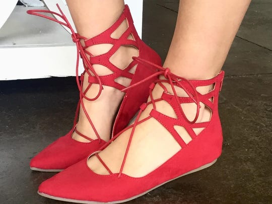 A strappy pair of red shoes are perfect for adding