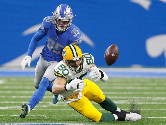Dec 29, 2019; Detroit, Michigan, USA; Green Bay Packers tight end Jimmy Graham (80) unable to make a catch against Detroit Lions defensive back Miles Killebrew (35) during the first quarter at Ford Field. Mandatory Credit: Raj Mehta-USA TODAY Sports