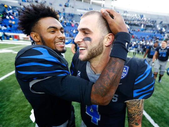 Memphis starting quarterback Riley Ferguson celebrates with his backup, David Moore, after defeating SMU last season.