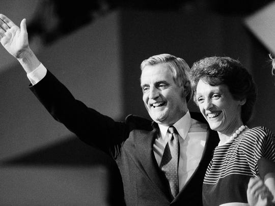 In this July 19, 1984 file photo, then Democratic presidential nominee Walter Mondale and his wife Joan smile broadly as they thank the delegates from the podium following Mondale's nomination in San Francisco.