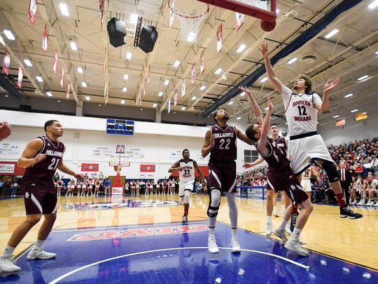 Playing before a packed house University of Southern Indiana's Julius Rajala (12) takes a shot in the paint as the USI Screaming Eagles play the Bellarmine Knights at USI's Physical Activities Center Saturday, February 10, 2018.