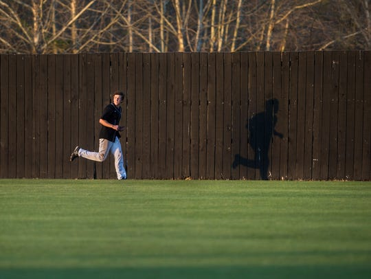 TCA's Lane Forsythe runs across the field Monday, April