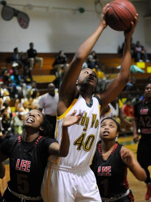 Jasmine Walker of Jeff Davis grabs a rebound over Robert E. Lee's Tiara Tatum (5) and Jaquesha Perkins (1) on Friday.