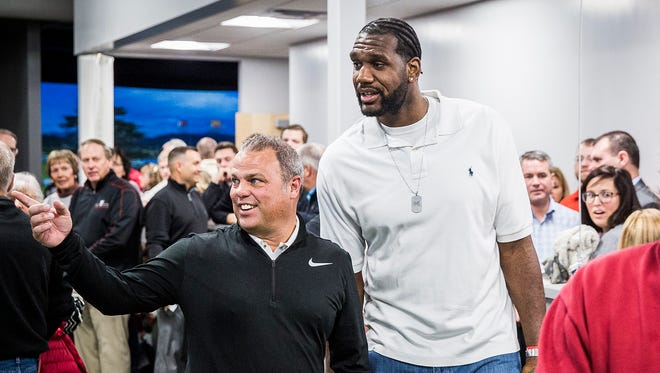 Former NBA player Greg Oden chats with Ball State golf coach Mike Fleck before a ribbon cutting ceremony for the Earl Yestingsmeier Golf Center Saturday morning. Oden was friends with former BSU golfer Travis Smith who died in a car crash. The university named the indoor short game practice area after Smith.